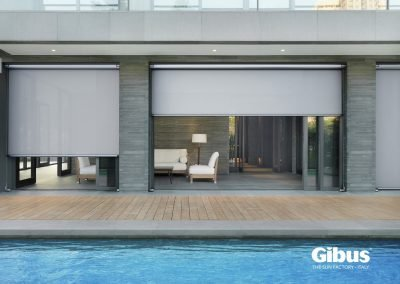Outdoor swimming pool along modern home
